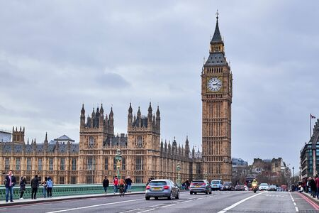 LONDON CITY - DECEMBER 24, 2016: People a and cars  on Westminster Bridge with Big Ben and the Parliament in the background