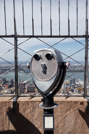 NEW YORK CITY - OCTOBER 9, 2014: Tourist binoculars on the top of Empire State building, facing the hudson River Stock Photo