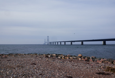 Great belt bridge seen from the Sealand side with a rocky terrain in the front