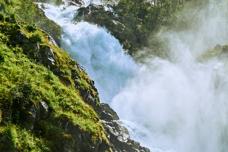 Close-up of the gushing water spray at Laatefossen waterfall in Norway Stock Photo