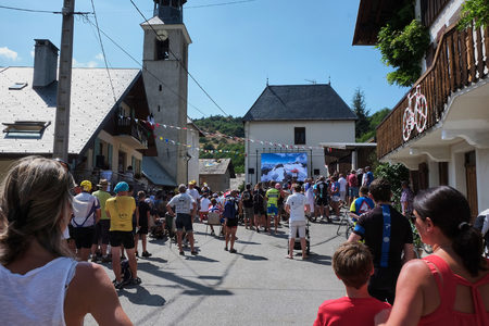 MONTVERNIER, FRANCE - JULY 23, 2015: people gathered in a small town square to watch tour de france 2015 on a big screen before the riders actually passes the town Editorial