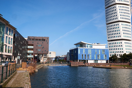 MALMO, SWEDEN - MARTS 28, 2014: Apartment buildings surrounding the canal in West Harbour area in Malmö Sweden