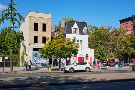 NEW YORK CITY - OCTOBER 17, 2014: Life around Downtown Baptiste Church in Harlem on a friday morning