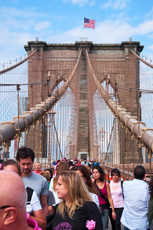NEW YORK CITY - OCTOBER 18, 2014: People, participating in Avon The walk to end breast cancer, crossing Brooklyn Bridge