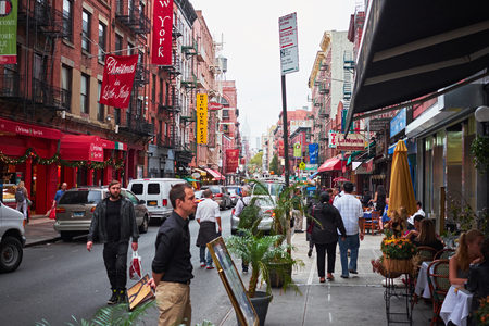 NEW YORK CITY - OCTOBER 15, 2014: Looking up Mulberry Street in Little Italy with the famous all year round christmas shop