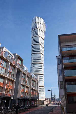 MALMO, SWEDEN - MARTS 28, 2014: The West Harbour area in Malmö in Sweden, with the Turning Torso in the background