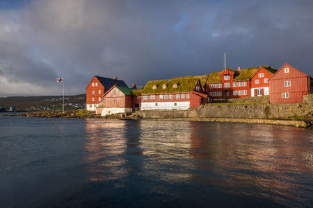 Tinganes Peninsula on a sunny Morning in Torshavn the capital of the Faroe Islands. Tinganes is the historic location of the Faroese parliament among other buildings 版權商用圖片