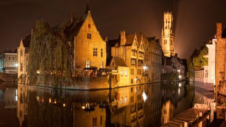 Reflections in a canal in Bruges, Belgium