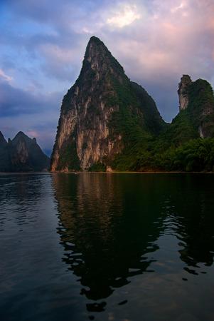 Karst peak reflecting in the Li River, Yangshuo, China