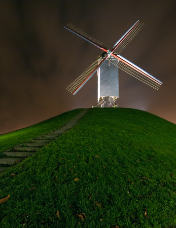 gristmill: Windmill on top of the hill at nightfall