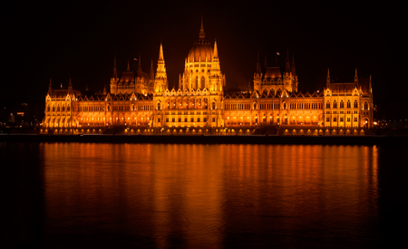 hungarian: The Hungarian Parliament building by Night, reflected in the Danube river Stock Photo
