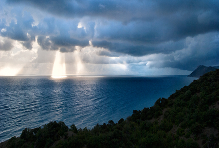 Sunray's breaking through the clouds after heavy rain at the coast of the Black Sea, Russia Stockfoto