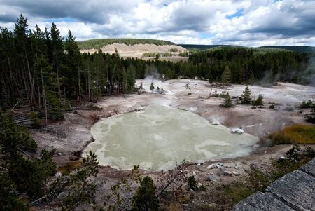 Green boiling sulfur pool in Yellowstone National Park