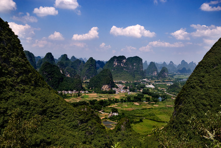 A green valley between the karst peaks in Yangshuo, China