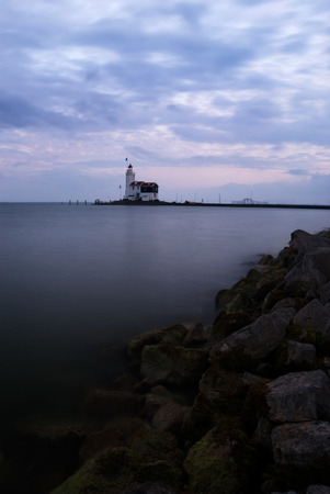 Lighthouse at sunset, called The Horse of Marken, Marken, The Netherlands