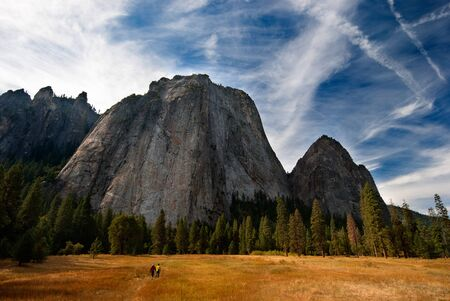 Massive rock in Yosemite National Park makes the people in the foreground look insignificant