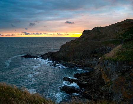 Rocky coastline at sunset, Normandy, France Stockfoto