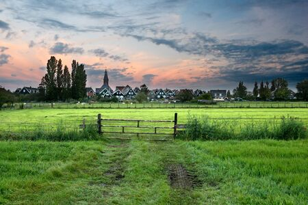 The rural village of Marken, located at the IJsselmeer in the north of Holland, waking up at sunrise.