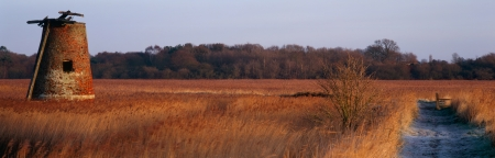 suffolk: Water Pump on Walberswick Marshes  Suffolk in a panoramic format Stock Photo