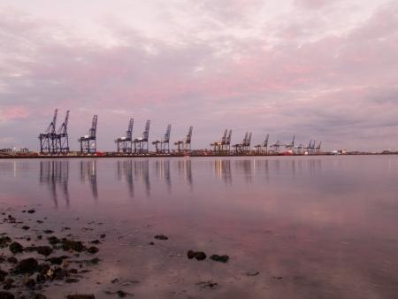 felixstowe: The Port of Felixstowe docks reflected in the sea.