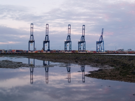 felixstowe: A view across a river of dock cranes in the UK Stock Photo