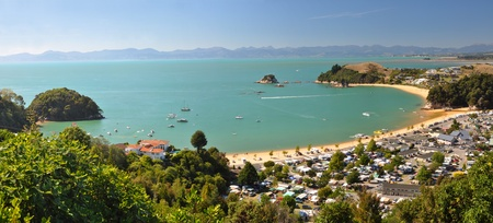 Kaiteriteri camp and beach panorama, Abel Tasman National Park, New Zealand  In the background are the towns of Mapua, Motueka and Nelson
