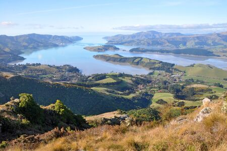 A panoramic view of Lyttleton Harbour at low tide from the top of the Christchurch Port Hills, Canterbury, New Zealand