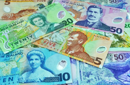 five dollars: New Zealand currency including five, ten, twenty and fifty notes. Feature famous New Zealanders including Sir Edmund Hillary, Sir Aparana Ngata, Kate Sheppard and the Monarch Queen Elizabeth II. Stock Photo