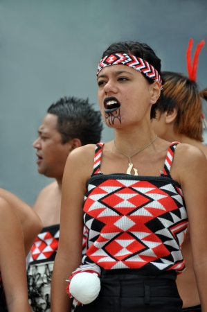 Christchurch, New Zealand - January 23, 2011: Maui, a traditional Maori song and dance group group, perform Maori Haka at the 18th World Buskers Festival.