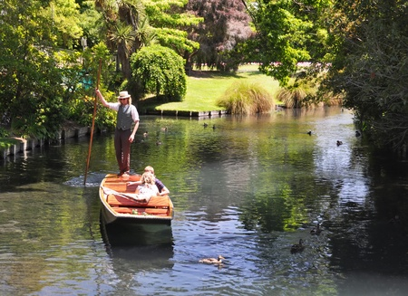 A boatman guides a young couple in their punt down the Avon River on December 09, 2010, Christchurch, New Zealand.