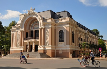 The Saigon Opera House with Cyclos on Dong Khoi Street on June 04, 2011, Ho Chi Minh City, Vietnam.