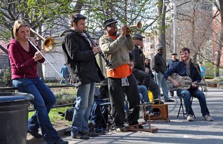 Traditional Jazz Band playing dixieland music for the people in Washington Square, Greenwich Village, New York on April 09, 2008.