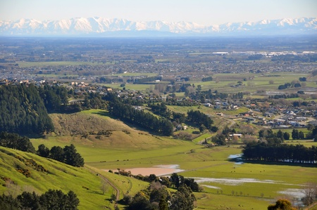 The Canterbury Plains featuring the outskirts of the city of Christchurch in the foreground and the Southern Alps in the far distance