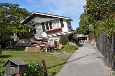 richter: Christchurch, New Zealand - March 26, 2011: House in Avonside collapses in the largest earthquake Christchurch has ever experienced - 7.1 on the Richter Scale on March 26, 2011 in Christchurch.