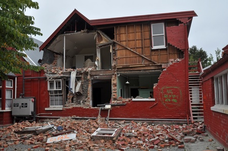 Christchurch, New Zealand - March 12, 2011: A brick house on historic Cranmer Square collapses from the impact of the massive  earthquake on March 12, 2011 in Christchurch. Stock Photo - 12571768