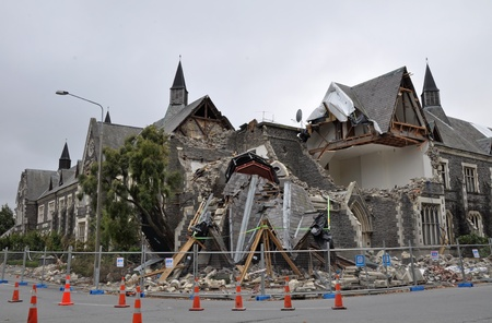 Christchurch, New Zealand - March 12, 2011: The old Normal School Building on the corner of Montreal and Kilmore streets collapses. The building was being restored from the September 4th 2010 earthquake damage when the devastating February 22nd 2011 earth