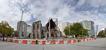 Christchurch, New Zealand - March, 2012: Panoramic view of the ruins of the Anglican Cathedral on March 10, 2012 in Christchurch. In the background cranes dismantle the remaining office blocks in the CBD.