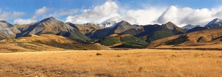 Panoramic view of the autumn colours of high country Canterbury. Includes  Broken River and Cheeseman Ski field areas. South Island, New Zeland. Stock Photo