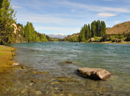 The crystal clear waters of the Clutha river in Otago, New Zealand, One of New Zealand Stock Photo