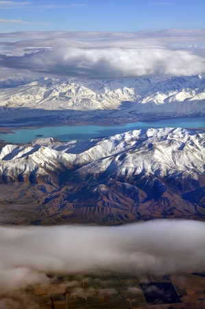 The Colours of Central Otago, New Zealand  lake Tekapo and the Southern Alps mountains in the background  Stock Photo