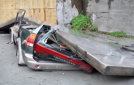 Christchurch, New Zealand - March 2011: A car is crushed by a collapsed concrete wall on March 20, 2011 in Christchurch following a 6.2 magnitude earthquake. Editorial