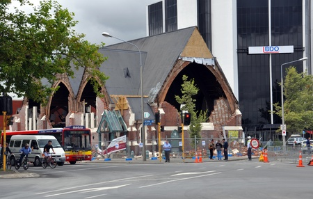Christchurch, New Zealand - February 2011: The remains of the historic Knox Church on February 23, 2011 in Bealey Avenue, Christchurch. Subsequently the modern office building in the background has had  to be completely demolished while the church is bein Stock Photo - 13063991