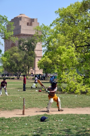 batsman: New Delhi, India - April 08, 2012: Cricketers flock to the park on a sumny Spring Sunday morning to play India