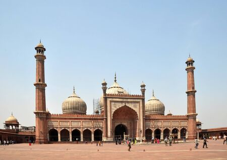 Delhi, India - April 09, 2012: The Jama Masjid Mosque is the largest in India and 25,000 people pray in the square at noon every Friday. Created by the Mughal empire in 1658.
