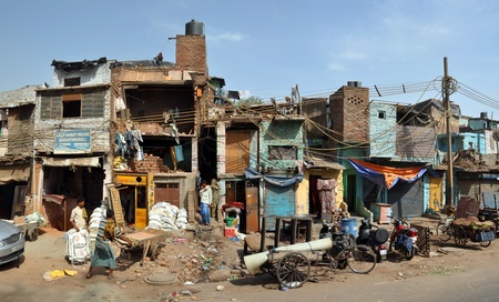 Delhi, India - April 08, 2012: Panoramic view of a section of slum houses and residents in Old Delhi.