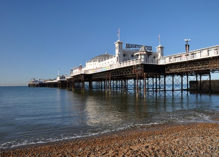 brighton beach: Brighton, United Kingdom - April 16, 2012: Vertical panoramic view of the famous Brighton Pier on a beautiful Spring day. Editorial