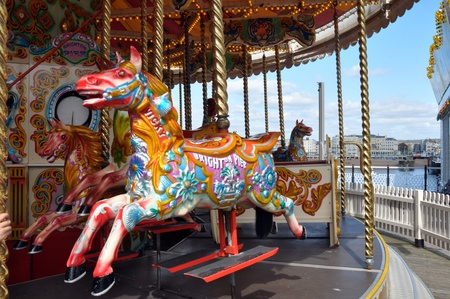 Brighton, United Kingdom - April 16, 2012: A beautifully painted horse on a Brighton Pier Carousel.