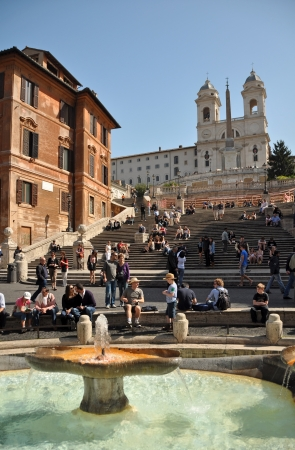 Visitors flock to the Spanish Steps in the week before the easter holidays. In the background is the church of Trinita del Monte. Rome, Italy, 12 April 2011.