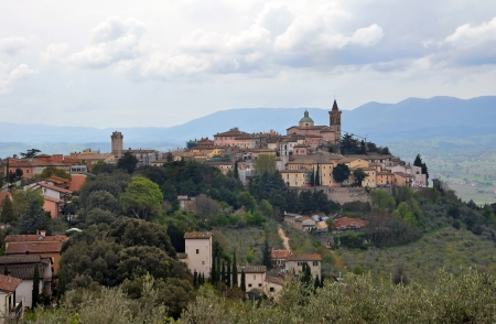 The historic town of Trevi perched on a steep hillside overlooking the valle of Umbria, Italy.