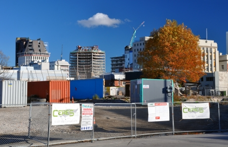await: Christchurch, New Zealand - May 27, 2012: Some of the last tall buildings in the CBD await demolition including the Holiday Inn and Canterbury Centre. These buildings have been deserted since the major earthquake struck in February 2011.